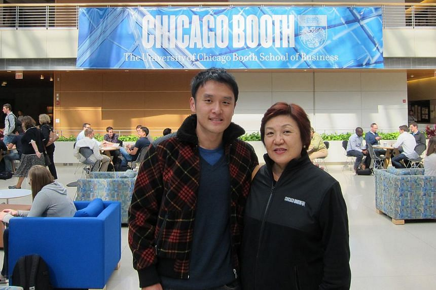 MBA student Cho Wei Hao (above, with his mother Madam S.T. Yeo at the University of Chicago Booth School of Business) will work in the finance industry in New York after he graduates in June. He says industries such as management consulting and finan