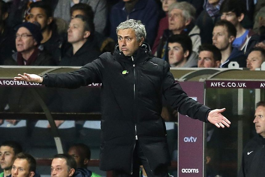 Chelsea manager Jose Mourinho reacts during their English Premier League soccer match against Aston Villa at Villa Park in Birmingham, central England, on March 15, 2014. -- PHOTO: REUTERS