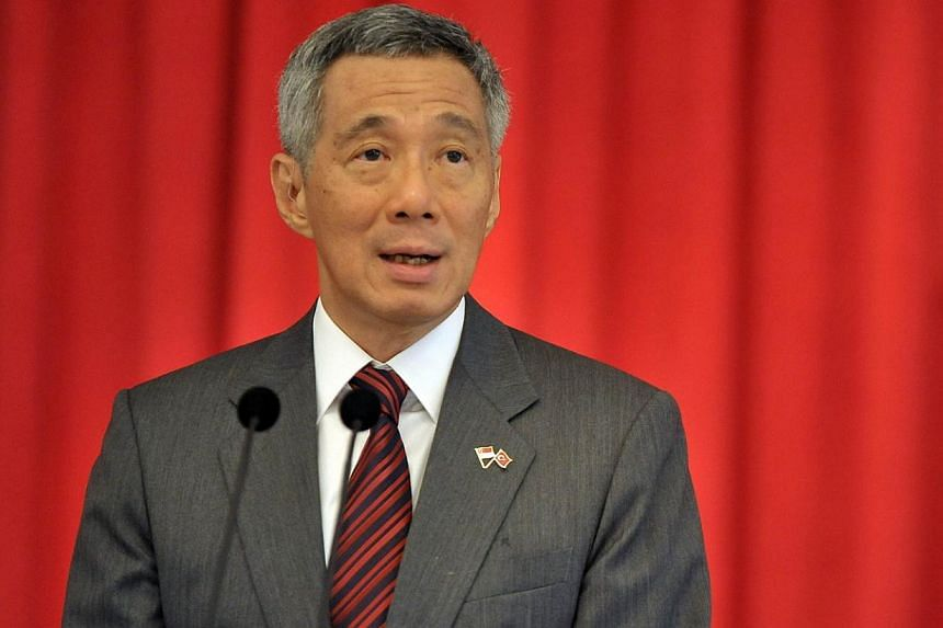 """Prime Minister Lee Hsien Loong has become the latest politician to comment on a recent BBC article in which a British writer wrote that Singapore suffers from a """"massive compassion deficit"""". -- FILE PHOTO: AFP"""