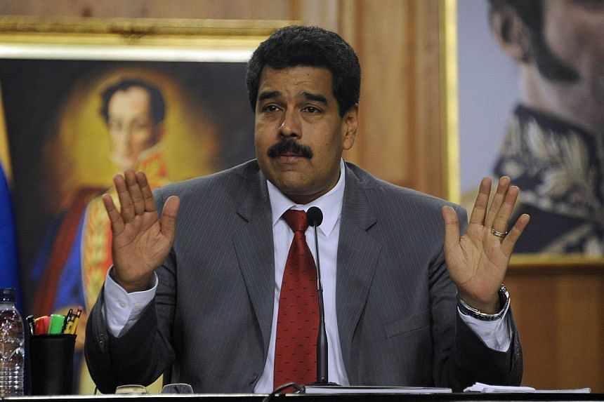 Venezuela's President Nicolas Maduro warned protesters in Caracas on Saturday to clear a square they have made their stronghold, or face eviction by security forces. -- PHOTO: AFP