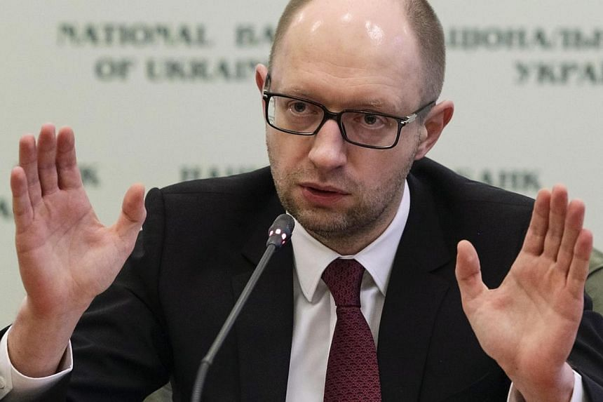 "Ukrainian Prime Minister Arseny Yatseniuk vowed on Sunday, March 16, 2014, to track down and bring to justice all those promoting separatism in its Russian-controlled region of Crimea ""under the cover of Russian troops"". -- FILE PHOTO: REUTERS"