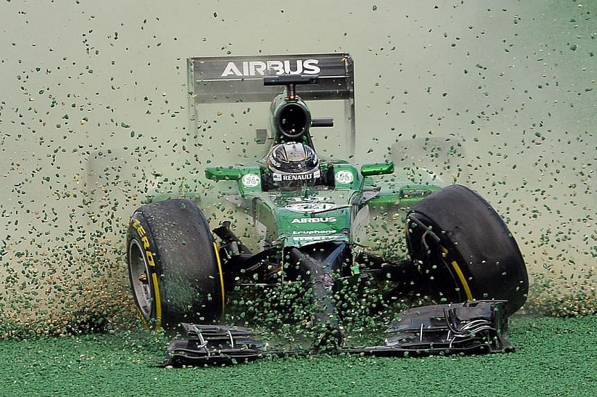The car of Caterham-Renault driver Kamui Kobayashi of Japan veers off the track during an accident at the start of the Formula One Australian Grand Prix in Melbourne on March 16, 2014. Kobayashi was cleared of any blame over a first-lap crash at