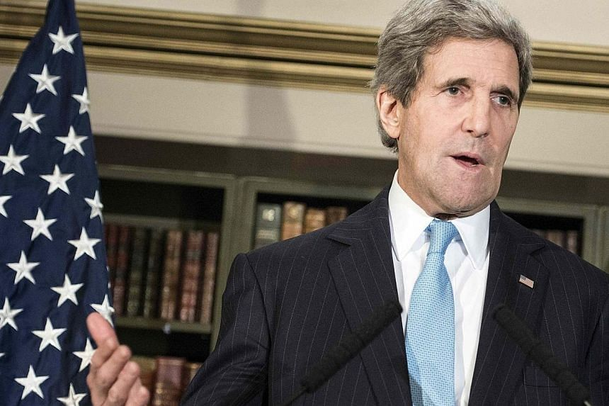 "US Secretary of State John Kerry speaks during a press conference in London, March 14, 2014. An Israeli minister on Sunday, March 16, 2014, said Washington's top diplomat was ""wrong"" for pressuring Israel in peace talks, a day before Palestinian"