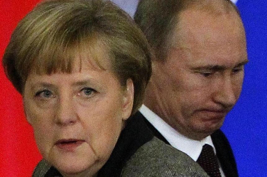 German Chancellor Angela Merkel (left) told Russian President Vladimir Putin more Organisation for Security and Cooperation in Europe (OSCE) observers should be sent to Ukraine, a plan he welcomed, Ms Merkel's spokesman said on Sunday, March 16, 2014