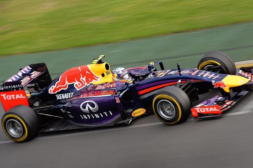 Red Bull driver Daniel Ricciardo of Australia speeds along the track in the Formula One Australian Grand Prix in Melbourne on March 16, 2014. Ricciardo was disqualified from his sensational second-place finish at the Australian Grand Prix for br