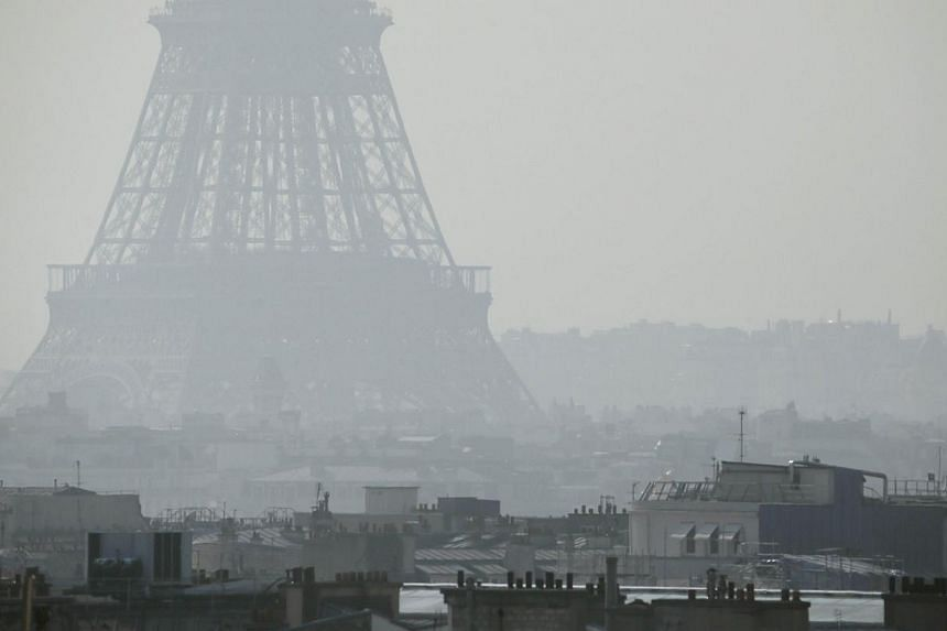 France will introduce driving restrictions in Paris on Monday, March 17, 2014, to tackle dangerous pollution levels, the first such ban in 20 years as politicians try to get rid of health-threatening smog days before municipal elections. -- PHOTO: AF