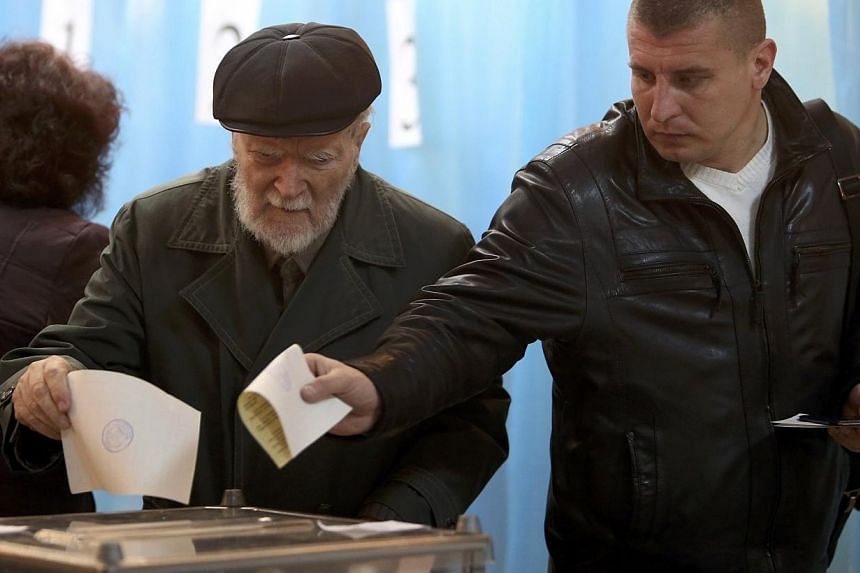 Voting got underway in Crimea on Sunday, March 16, 2014, as the inhabitants of this Ukrainian region began to cast their ballots in a referendum aimed at deciding whether the peninsula leaves Ukraine and becomes part of Russia. -- PHOTO: REUTERS
