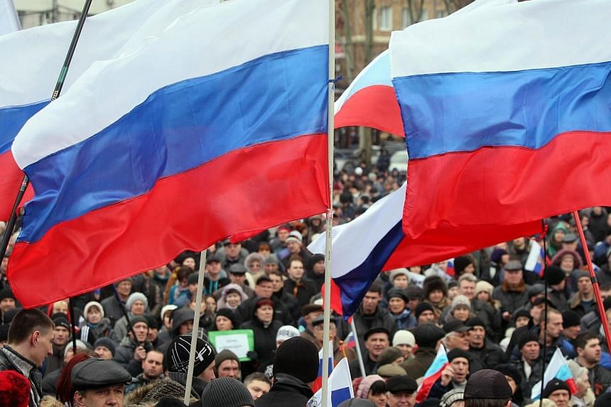 Thousands of pro-Russian protesters in the east Ukrainian city of Donetsk rallied on Sunday, March 16, 2014, in support of Crimea's right to join Russia and to press for their own referendum. -- PHOTO: AFP