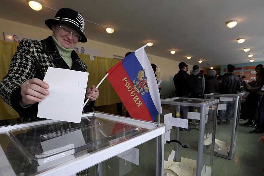 A woman voting at apolling station in Bakhchisaray on Sunday.Voters were seen casting their ballots even before the official start of Crimea's referendum on Sunday, March 16, 2014, at a polling station in Sevastopol in one of several poss