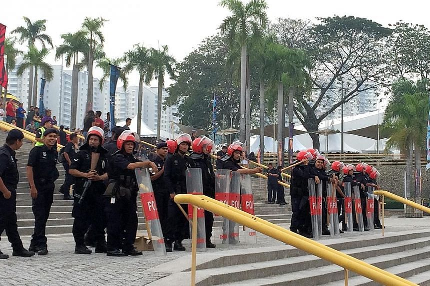 Riot police on standby at the entrance on Future Music Festival Asia at Bukit Jalil National Stadium when it was announced that the third day of the festival was cancelled. The Ministry of Foreign Affairs (MFA) is rendering consular assistance