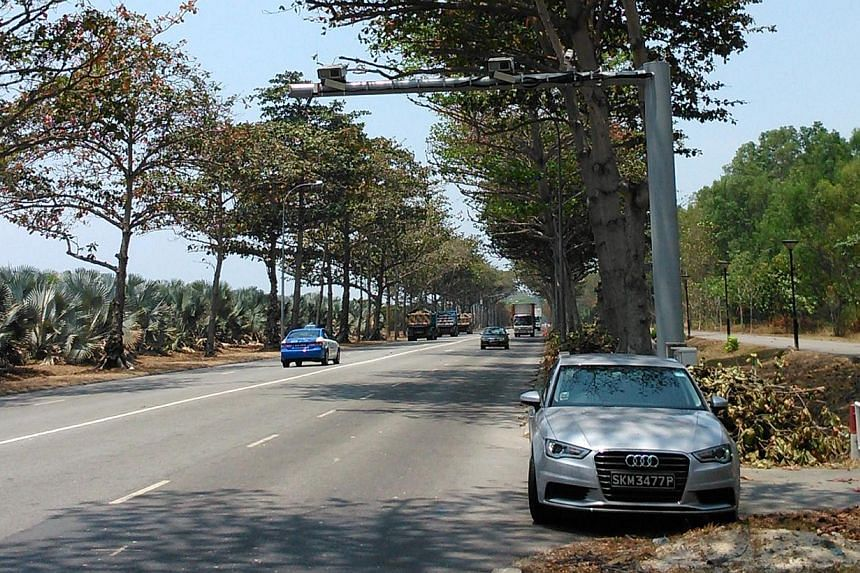 """These """"average speed cameras"""" along Changi Coastal Road calculate a vehicle's average speed over a stretch. -- ST PHOTO: CHRISTOPHER TAN"""