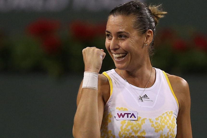 Flavia Pennetta of Italy celebrates following her victory over Li Na of China during the BNP Paribas Open at Indian Wells Tennis Garden in California on March 14, 2014. Pennetta captured the biggest title of her career on March 17, when she beat Pola