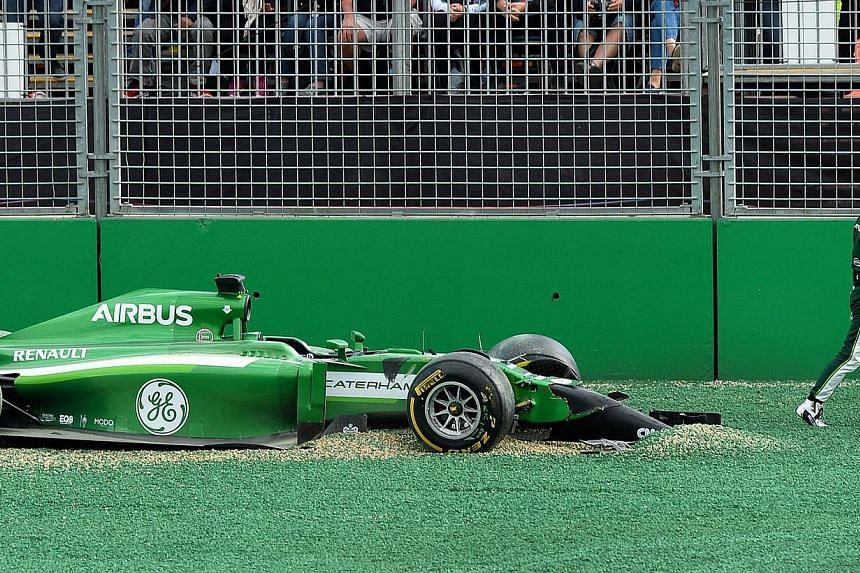 Caterham driver Kamui Kobayashi of Japan walks away from his car after crashing on the first corner in the Formula One Australian Grand Prix in Melbourne on March 16, 2014. Japan's Kamui Kobayashi sarcastically hit back at his critics on Monday, afte