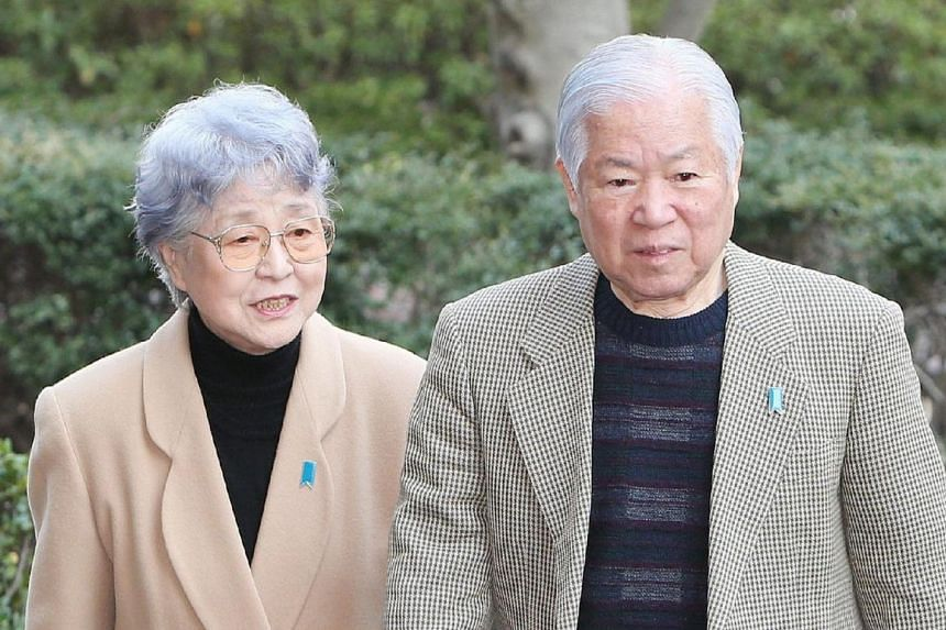 Mr Shigeru Yokota (right) and his wife Sakie (left), whose daughter was kidnapped in 1977 by North Korean agents, walk to a press conference in Kawasaki, a suburb of Tokyo, on March 17, 2014. After a hiatus of more than a year, Japan and North Korea