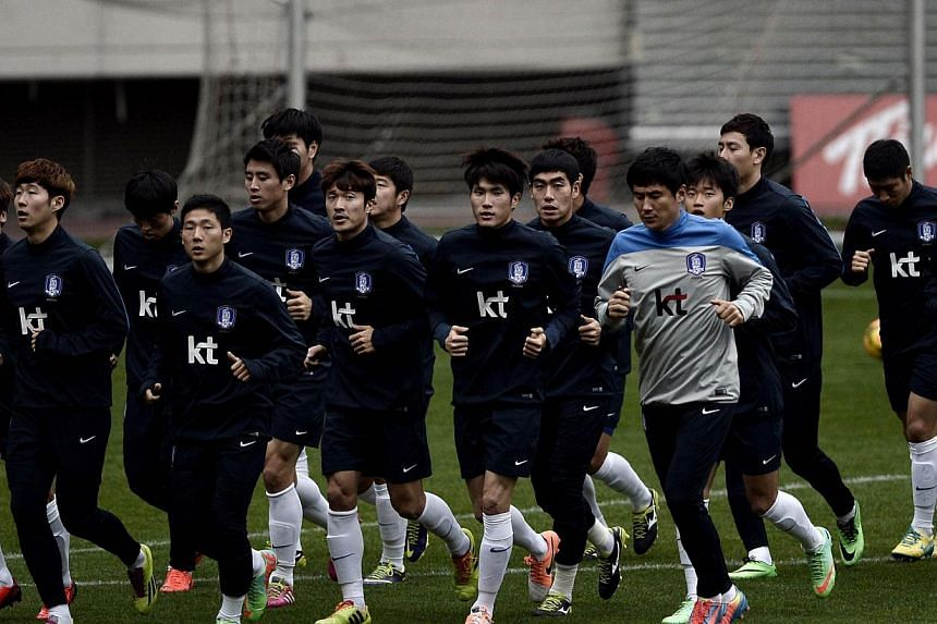 South Korea's national football team players run training session at Karaiskaki stadium in Athens on March 4, 2014 one day before the friendly match between Greece and the Repulic of Korea. South Korea will loom as dangerous floaters in the second po
