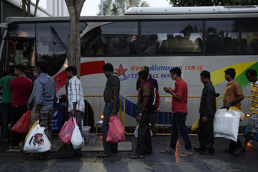 "Restrictions on the number of private buses ferrying workers to and from Little India on Sundays have been kept ""fluid"" by the Land Transport Authority, the Committee of Inquiry into the Dec 8 riot was told. -- ST FILE PHOTO: DESMOND LIM"