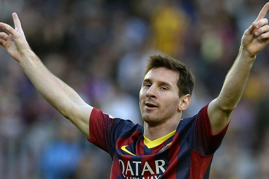 Barcelona's Argentinian forward Lionel Messi celebrates after scoring a goal during the Spanish league football match against Osasuna at the Camp Nou stadium in Barcelona on March 16, 2014. -- PHOTO: AFP