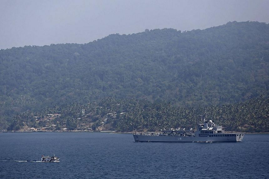 Indian Navy ship INS Kesari, involved in search operations for the missing Malaysia Airlines Flight MH370, arrives at the naval base in Port Blair, the capital of India's Andaman and Nicobar islands, March 17, 2014. India rejected suggestions on
