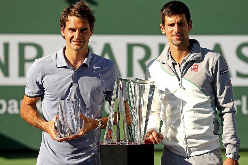 Roger Federer of Switzerland (left) and Novak Djokovic of Serbia pose for photographers after their match during the final of the BNP Parabas Open at the Indian Wells Tennis Garden in California, on March 16, 2014. -- PHOTO: AFP