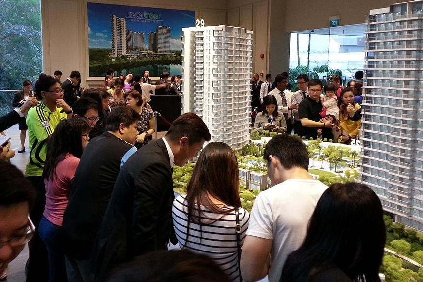 Potential buyers at Rivertrees Residences showflat, a waterfront condominium project in Sengkang. New private home sales rose 28 per cent in February, largely driven by two new launches in Sengkang that month. -- FILE PHOTO: RIVERTREES