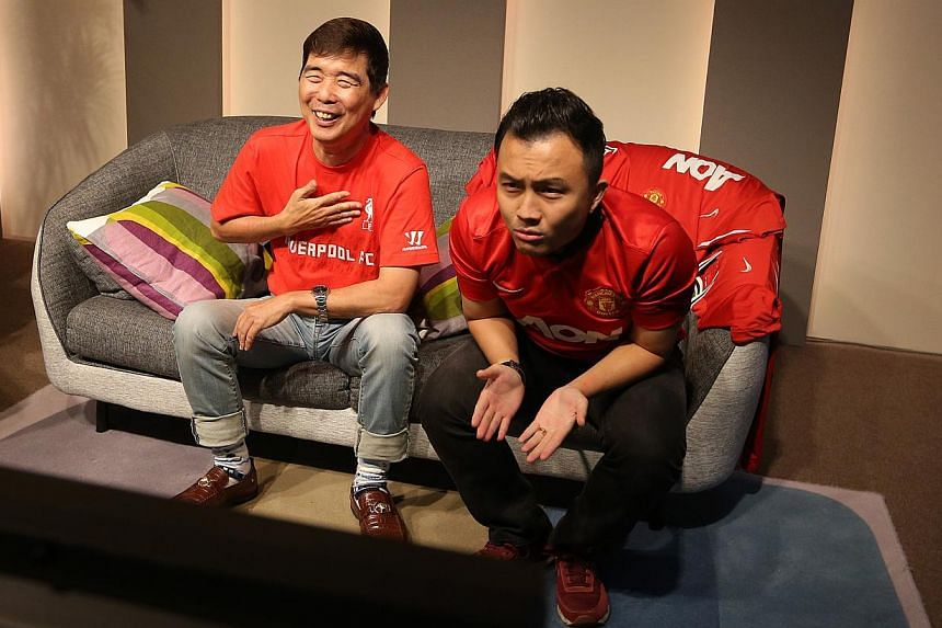 ST Sports organised a fan event for the Man Utd v Liverpool clash. Two fans provided commentary over the game while recorded in front of a video camera. -- ST PHOTO: ONG WEE JIN