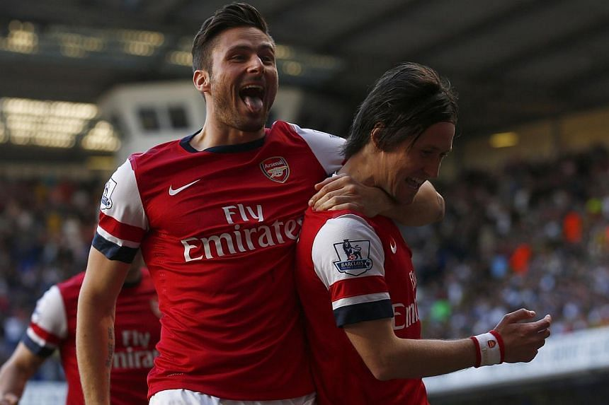 Arsenal's Tomas Rosicky (right) celebrating his goal against Tottenham Hotspur with Olivier Giroud during their English Premier League match at White Hart Lane in London on March 16, 2014. -- PHOTO: REUTERS