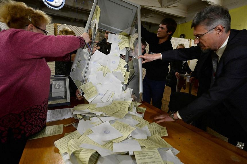 Members of a local electoral commission prepare to count ballots at a polling station in Simferopol on March 16, 2014.More than 95 per cent of voters in Ukraine's Crimea region supported union with Russia in a referendum on Sunday, according to