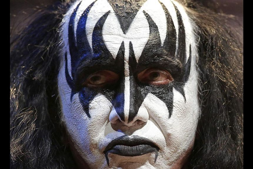 Gene Simmons, a member of rock band Kiss, is seen on stage during an announcement that Kiss and Def Leppard will team up this summer for a 42-city North American tour, at the House of Blues in West Hollywood, California March 17, 2014. The tour begin