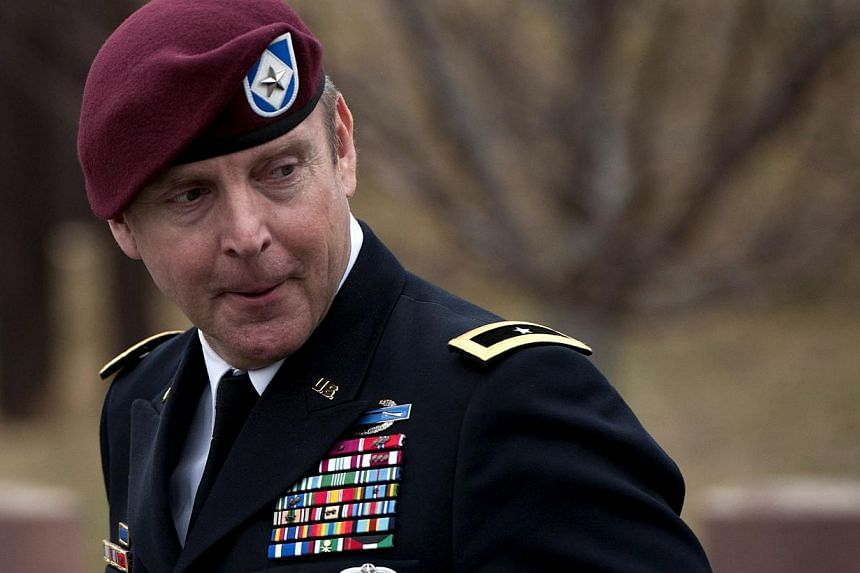 Brigadier General Jeffrey Sinclair leaving the Fort Bragg Courthouse after sexual assault charges against him were dropped after he plead to lesser charges on March 17, 2014 in Fort Bragg, North Carolina. -- PHOTO: AFP