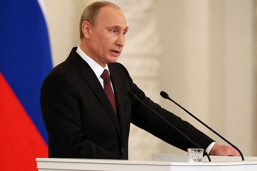 Russia's President Vladimir Putin addresses a joint session of Russian parliament on Crimea in the Kremlin in Moscow on March 18, 2014.Russia does not want Ukraine to be split apart, President Vladimir Putin said on Tuesday,March 18, 2014