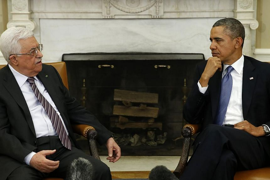 United States President Barack Obama meets with Palestinian Authority President Mahmoud Abbas (left) at the White House in Washington on March 17, 2014. -- PHOTO: REUTERS