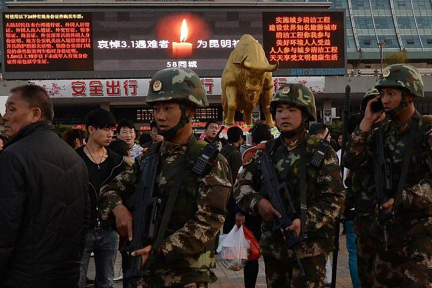 Chinese paramilitary police patrol outside the scene of the attack at the main train station in Kunming, Yunnan Province, on March 3, 2014.The Turkestan Islamic Party, amilitant Islamist group, has voiced support for a mass stabbing at a