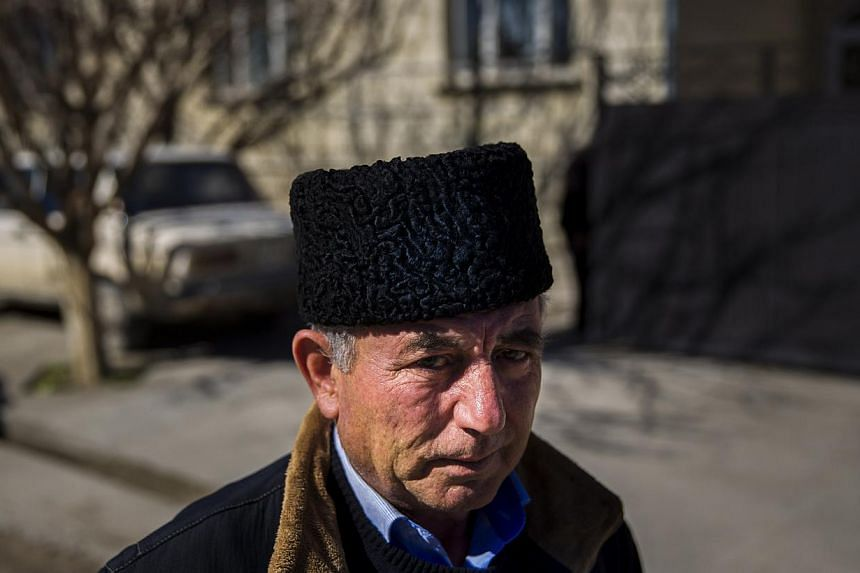 Mr Mustafa Asaba, a regional leader of Crimean Tatars, stands outside a friend's home in Belogorsk near the Crimean capital of Simferopol on March 17, 2014. Among the voices drowned out by victory celebrations across Crimea as it voted to leave