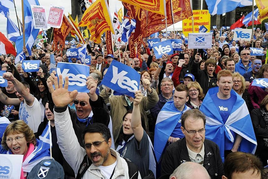 Pro-independence supporters at a rally in Edinburgh, Scotland, on Sept 21, 2013. -- FILE PHOTO: AFP
