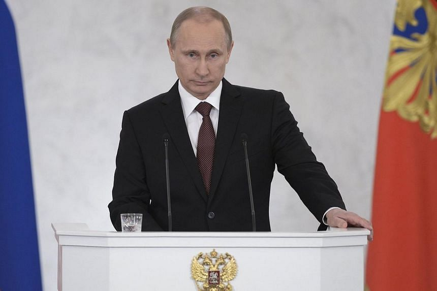 Russian President Vladimir Putin addresses the Federal Assembly, including State Duma deputies, members of the Federation Council, regional governors and civil society representatives, at the Kremlin in Moscow on Tuesday, March 18, 2014.Preside