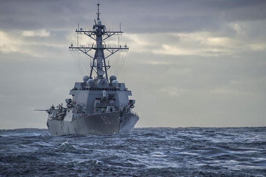 The US Navy Arleigh Burke-class guided-missile destroyer USS Roosevelt steams in the Atlantic while en route to the Mediterranean Sea on Feb 18, 2014. US Navy Seals operating from the USS Roosevelt captured an oil tanker on Monday, March 17, 2014, th