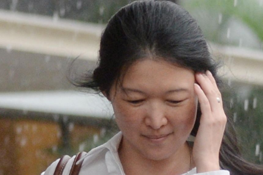 """Juraimi Kamaludin admitted in court to spitting on one of the women. He told the judge """"I can't reach her. If I can reach her, I would have slapped her."""" He accused another woman, Ms Teoh Lay Peng (above), of pushing him. -- ST PHOTO: WONG KWAI CHOW"""