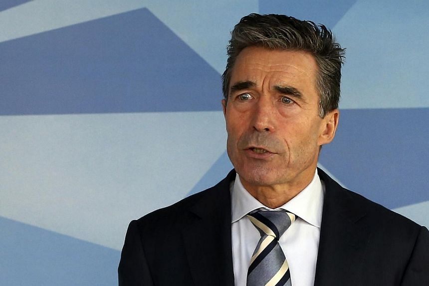 """Nato secretary general Anders FoghRasmussen added that he was """"deeply concerned"""" by reports of the death of a Ukrainian soldier.""""It is urgent that all sides show restraint and take all possible steps to avoid further escalation.""""--"""