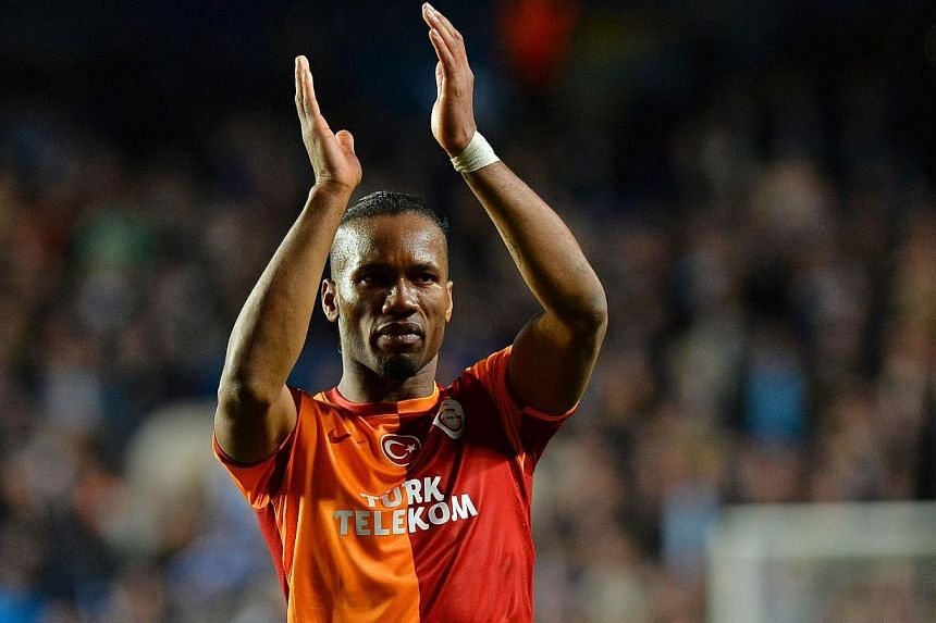 Galatasaray's Ivorian forward Didier Drogba acknowledges the crowd at the end of the UEFA Champions League round of 16 second leg football match between Chelsea and Galatasaray at Stamford Bridge in London, on March 18, 2014. -- PHOTO: AFP