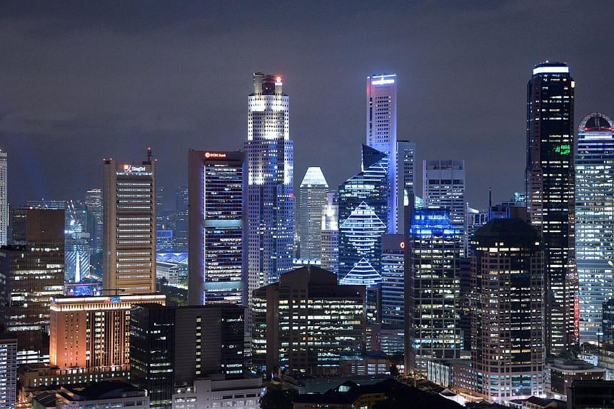 Private-sector economists have become slightly more cautious about Singapore's growth this year, according to the latest Monetary Authority of Singapore survey released on March 19, 2014. -- ST FILE PHOTO: LIM SIN THAI