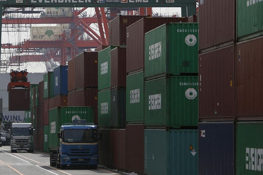 A port in Tokyo in February 2014. Japan's annual export growth in February was well below market expectations, but business confidence remained steady over the month - although that may not last too long. -- FILE PHOTO: REUTERS