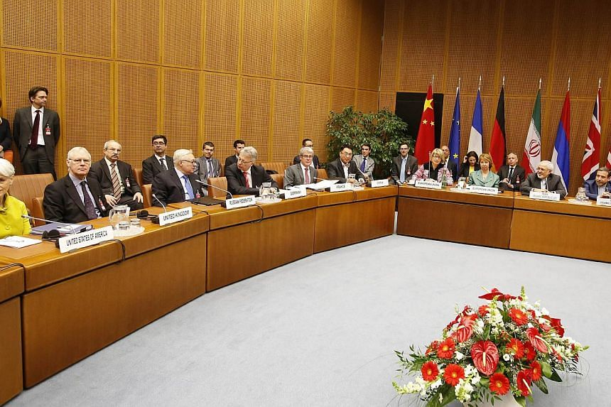 Catherine Ashton (4th right), High Representative of the Union of Foreign Affairs and Security Policy for the European Union, and Iranian Foreign Minister Mohammad Javad Zarif (2nd right) attend the first day of the second round of P5+1 talks with Ir
