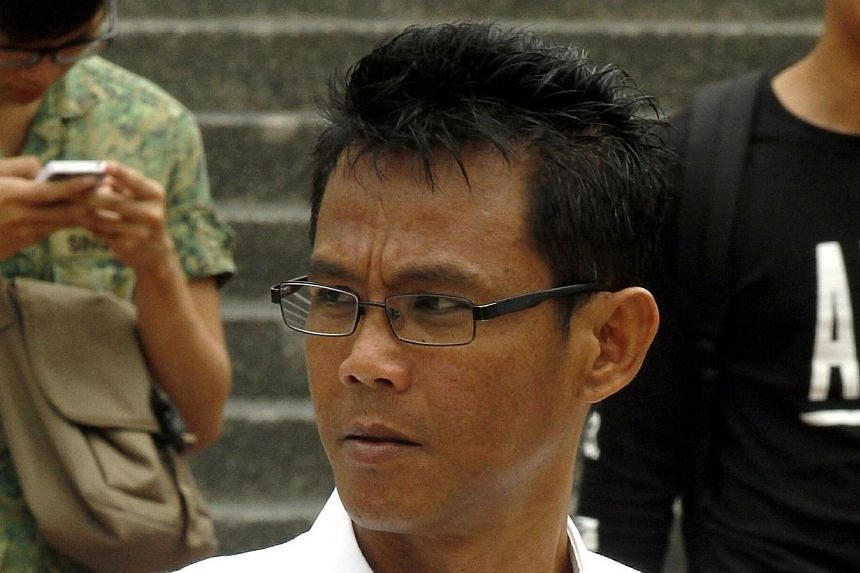 Former technician Juraimi Kamaludin, who spat at two women at Woodlands bus interchange last October, was convicted of five charges on Wednesday, March 19, 2014 after a three-day trial.-- ST PHOTO: WONG KWAI CHOW