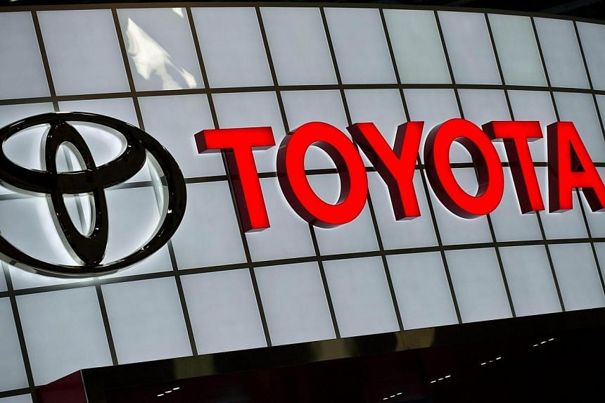 The Toyota logo is seen at the Washington Auto Show in this February 2, 2013 in Washington,DC. Toyota Motor will pay US$1.2 billion (S$1.5 billion) to settle US accusations that it sought to cover up an accelerator problem in Toyota and Lexus vehicle