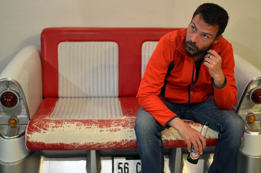 Former Societe Generale trader Jerome Kerviel sits in a Hotel in Modena on March 18, 2014. -- PHOTO: AFP