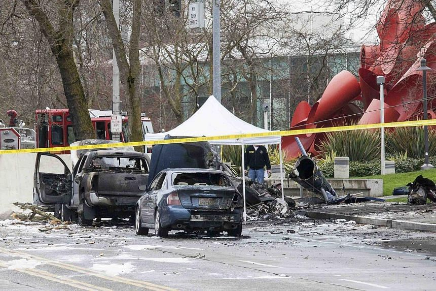 Wreckage is pictured where a television news helicopter crashed near the Space Needle in Seattle, Washington, on March 18, 2014. -- PHOTO: REUTERS