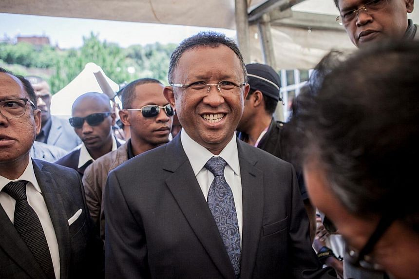 Madagascar's new president Hery Rajaonarimampianina (centre) is seeking to end his country's isolation that followed a 2009 coup that stalled the economy -- FILE PHOTO: AFP