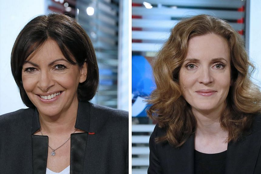 Paris mayoral candidates Anne Hidalgo (left), Paris deputy mayor and Socialist Party member and Nathalie Kosciusko-Morizet (right), conservative UMP political party member at the LCI studios in Boulogne-Billancourt before taking part in a televised d