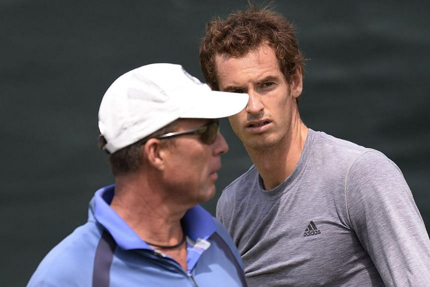 In a file picture taken on July 4, 2013, Britain's Andy Murray (right) and his coach Ivan Lendl (left) attend a training session at the practice courts on day ten of the 2013 Wimbledon Championships tennis tournament at the All England Club in Wimble
