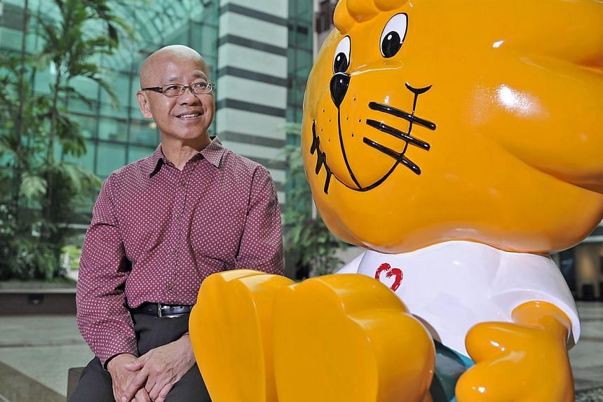 "Dr William Wan, general-secretary of Singapore Kindness Movement, sits next to Singa the lion, the official mascot of the Singapore Kindness movement. There has been much discussion on whether Singapore deserves its ""miserable"" tag, followin"